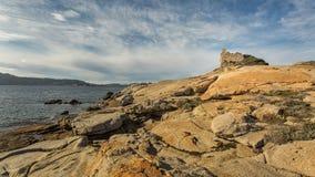 Genoese tower at Punta Caldanu near Lumio in Corsica Royalty Free Stock Images