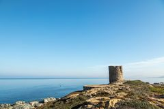 Genoese tower at Punta Spano in the Balagne region of Corsica. Genoese tower amongst the maquis and rocks at Punta Spano on the coast of the Balagne region of stock images