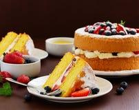 Genoise (cake) with cream, berries Stock Photos