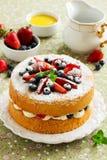 Genoise (cake) with cream, berries Stock Image
