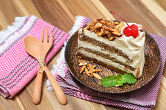 Genoise coffee cake on wooden plate Stock Photography