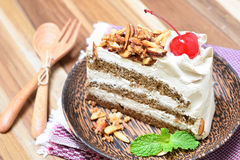Genoise coffee cake on wooden plate Royalty Free Stock Photo