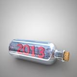 Genomskinlig flaska med ett meddelande Fotografering för Bildbyråer