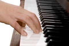 Genomskinlig hand som spelar pianot Arkivfoto