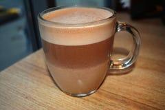 Genomskinlig kopp med kakao Arkivbilder