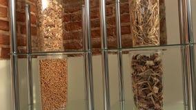 Genomskinliga askar med den olika sorten av ekologiskt bio bränsle för bio kulor lager videofilmer