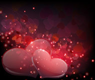 Genomskinliga hjärtor på sparkling bakgrund Royaltyfri Foto