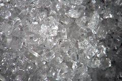 Genomskinliga kristaller för mikroskopiskt socker Matbakgrundstextur Toppen makronärbild vid mikroskopet Arkivfoton