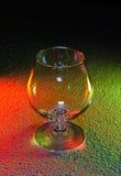 Genomskinligt exponeringsglas på en kulör bakgrund Royaltyfria Foton