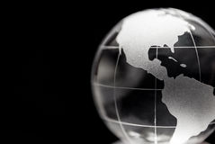 Genomskinligt jordklot med svart bakgrund royaltyfri bild
