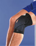 Genou enveloppé par bandage Image stock