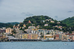 Genova coastline and beach. Colorful houses and church of Pegli district in Genova, Italy. The port and seascape view of the town of Genoa Stock Photos