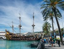 GENOVA, ITALY - JUNE 21, 2016: People walking near Galeone Neptune, old wooden ship, replica of old spanish galleon at the old. GENOVA, ITALY - JUNE 21, 2016 royalty free stock image