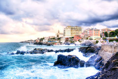 Genova Quinto with rough seas. HDR. View of the city of Genova Quinto (Italy) with wave in foreground Stock Image