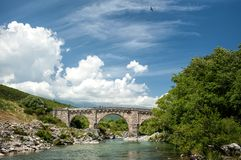 Genovese bridge near Altiani (Corsica). The Genovese Bridge at Altiani over Tavignanu river is classified as a historical monument. Until 11 July 2011 it was Stock Photography