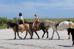 Gens d'équitation Photos stock