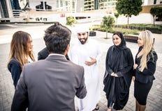Gens d'affaires arabes et occidentaux Image stock