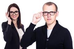 Gens d'affaires avec de nouvelles lunettes d'isolement sur le blanc Image stock