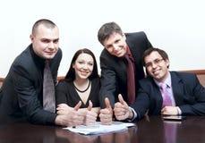 Gens d'affaires avec des pouces vers le haut à une conférence Photos stock
