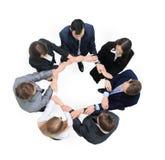 Gens d'affaires avec leurs mains ensemble en cercle Image libre de droits