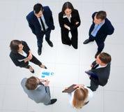 Gens d'affaires avec leurs mains ensemble en cercle Photo stock