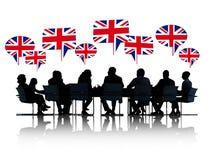 Gens d'affaires britanniques parlants de silhouettes Photo stock