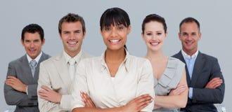 Gens d'affaires confiant avec les bras pliés Image stock