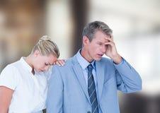 Gens d'affaires déprimés sur le fond brouillé Photographie stock