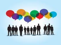 Gens d'affaires dans la communication et le discours coloré de bulle illustration libre de droits