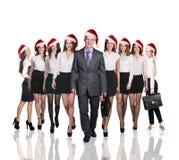 Gens d'affaires dans un chapeau de Noël Images stock