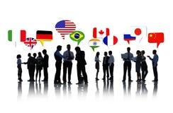 Gens d'affaires discutant des relations internationales Photos libres de droits