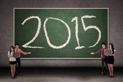 Gens d'affaires présent le numéro 2015 Image libre de droits