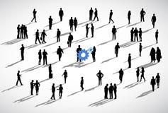 Gens d'affaires se tenant à un arrière-plan blanc avec bleu Photos libres de droits