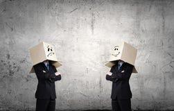 Gens d'affaires utilisant des boîtes Images stock