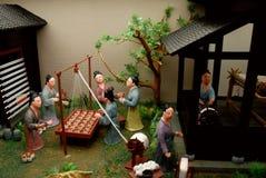 Gens de jouet effectuant la soie Photos libres de droits
