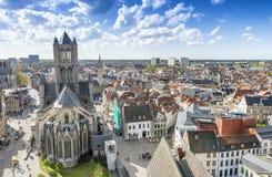 GENT, BELGIUM - MARCH 2015: Tourists visit ancient medieval city Stock Images