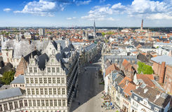 GENT, BELGIUM - MARCH 2015: Tourists visit ancient medieval city Stock Image