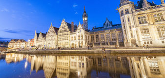 GENT, BELGIUM - MARCH 2015: Tourists visit ancient medieval city. At night. Gent attracts more than 1 million people annually Royalty Free Stock Images