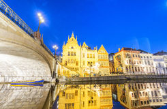 GENT, BELGIUM - MARCH 2015: Tourists visit ancient medieval city Stock Photos
