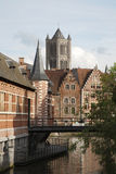 Gent - tower of st. Nicholas and brick houses. Royalty Free Stock Photos