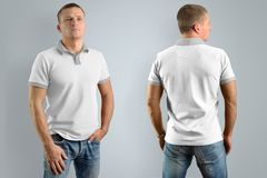 Gent young man in the white polo shirt.  Mockup for your graphic. Gent young man in the white polo shirt and blue jeans  isolated on the gray background, front Stock Photo