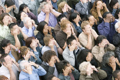 Gente étnica multi que cubre sus ojos Foto de archivo