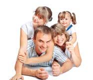 Gente alegre de la familia de cuatro miembros Imágenes de archivo libres de regalías
