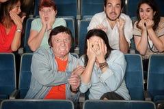 Gente asustada en teatro Imágenes de archivo libres de regalías