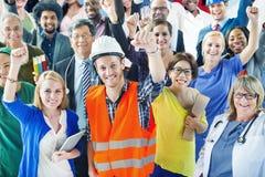 Gente con los diversos brazos de los empleos aumentados Imagen de archivo libre de regalías