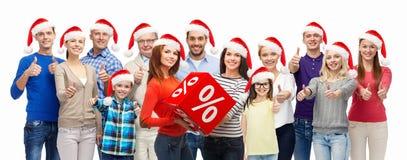 Gente con los panieres en la venta de la Navidad Imagenes de archivo