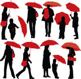Gente con los paraguas Fotografía de archivo libre de regalías