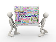 gente 3d que sostiene etiquetas de la palabra del wordcloud del trabajo en equipo Foto de archivo libre de regalías