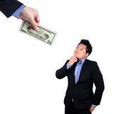Gente de la caza del hombre de negocios con el dinero Imágenes de archivo libres de regalías