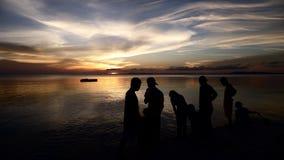 Gente de la puesta del sol Fotografía de archivo libre de regalías